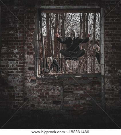 Photo of man in a gas mask in an old building