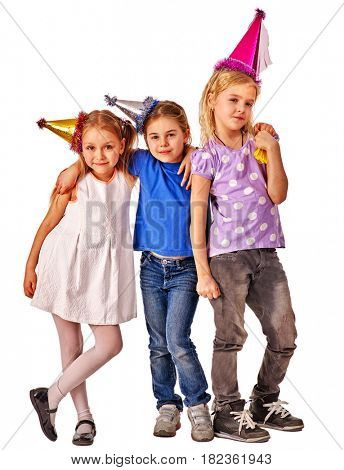 Birthday children celebrate party together with happy girl and boy. Portrait of three kids in party hat standing on isolated.