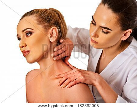 Shoulder and neck massage for woman in spa salon. Doctor making neck therapy in rehabilitation center on isolated.