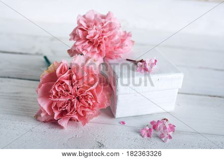 Mothers day decoration with pink blossoms and a gift in vintage style