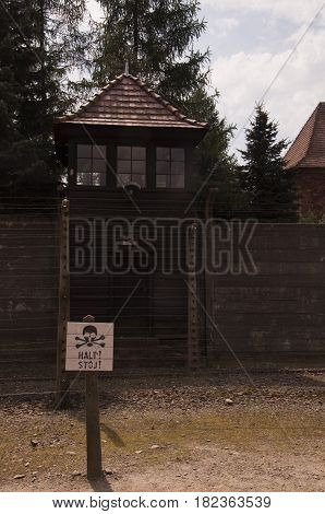 Watchtower And Wire Fence In Auschwitz-birkenau Concentration Camp.
