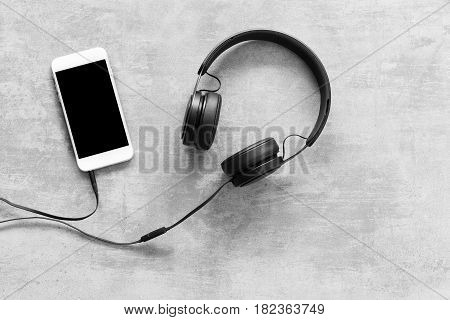 Headset And A Phone On Concrete Background