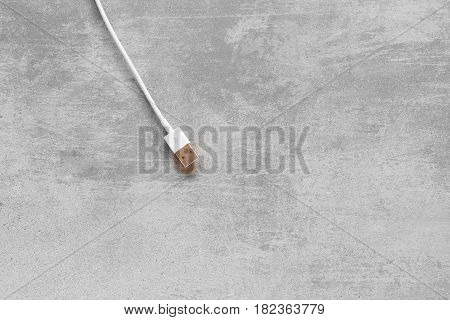 White Usb Cable On Concrete Background