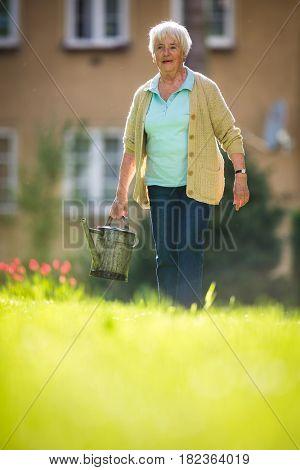 Senior woman doing some gardening in her lovely garden