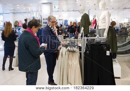 ENSCHEDE THE NETHERLANDS - APRIL 13 2017: Woman are shopping in clothes store C&A after it has been reopened.