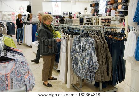 ENSCHEDE THE NETHERLANDS - APRIL 13 2017: Women are shopping in clothes store C&A after it has been reopened