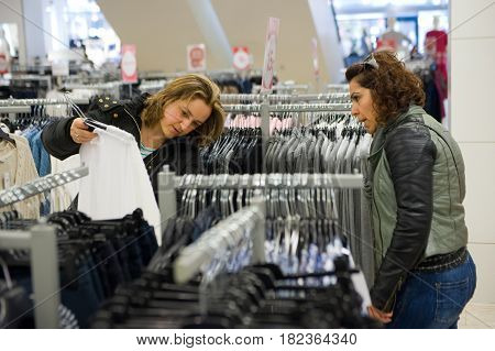 ENSCHEDE THE NETHERLANDS - APRIL 13 2017: Two women are shopping in clothes store C&A after it has been reopened.