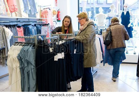 ENSCHEDE THE NETHERLANDS - APRIL 13 2017: Women are shopping in clothes store C&A after it has been reopened.