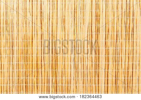 Brown bamboo straw mat. Macro. Photo can be used as a whole background.