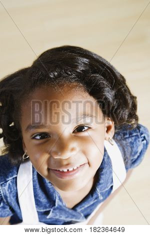 Smiling African girl looking up