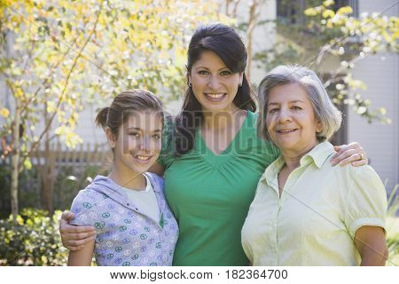 Multi-generational family posing