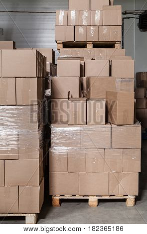 A lot of brown cardboard boxes at the storehouse