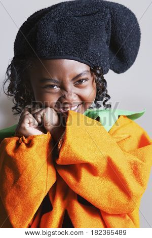 African girl wearing pumpkin costume