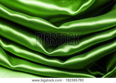 green crumpled silk fabric textured background