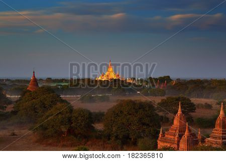 Landscape with illuminated Temples of Bagan in dusk after sunset, Myanmar (Burma)