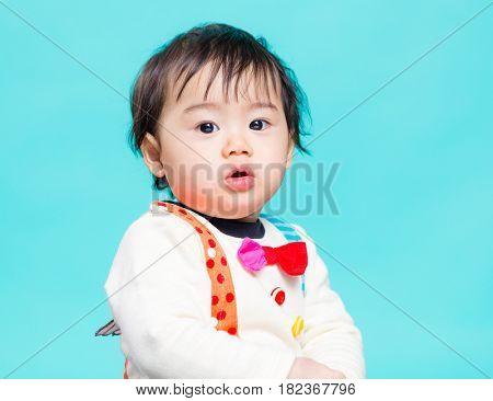 Little asian boy over blue background