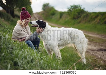 Girl playing with her dog outdoor
