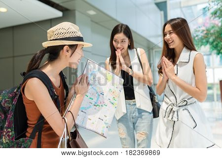 Woman travel in bangkok and saying goodbye with local people