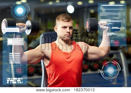sport, fitness, bodybuilding and people concept - young man with dumbbells flexing muscles in gym over virtual charts