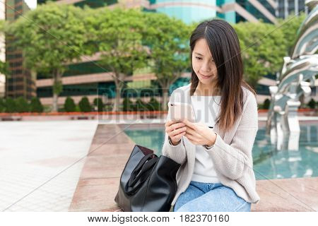 Young Woman using mobile phone at outdoor