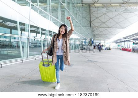 Thrilled woman going travel