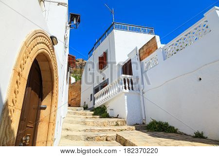 Narrow alley and traditional Greek architecture of Lindos, Rhodes Island,