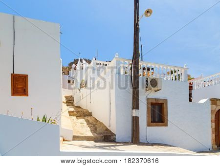 Narrow alley and traditional Greek architecture of the Lindos, Rhodes Island, Greece