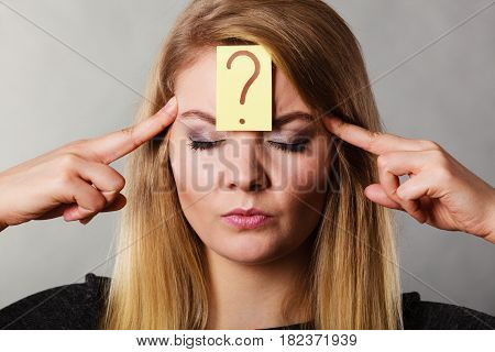 Woman Having Question Mark On Forehead