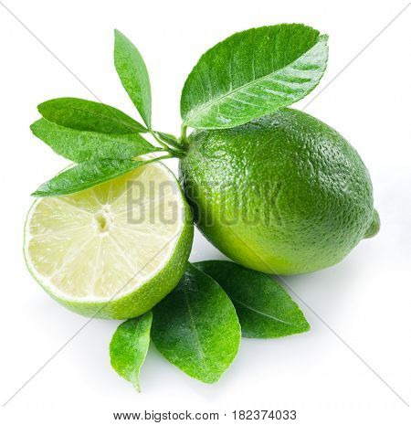 Ripe lime fruit with a half of lime on the white background.
