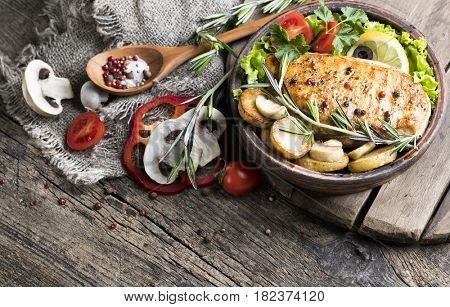 Fried chicken fillet and mushrooms with potatoes