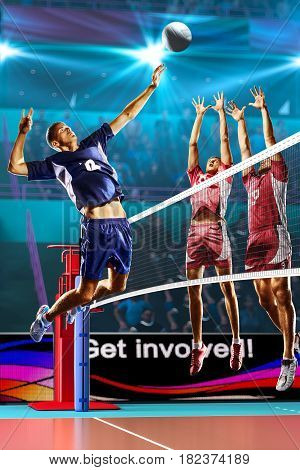 Professional volleyball players in action on the colour grand court