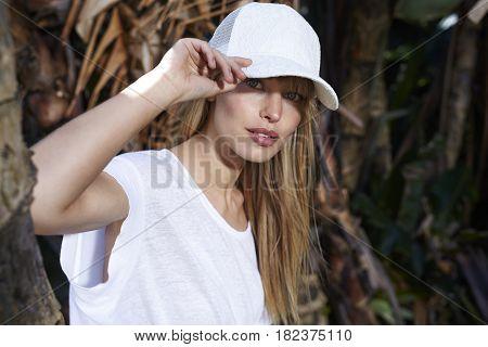 Portrait of blond beautiful woman wearing a cap