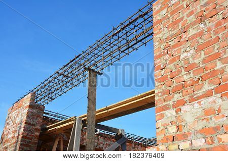 Lintel Construction. Rebar steel bars on new home construction corner reinforcement concrete bars with wire rod as a lintel for window. Brickwork with Iron Bars for Next Floor House Construction.
