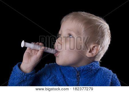 Child Taking Medicine