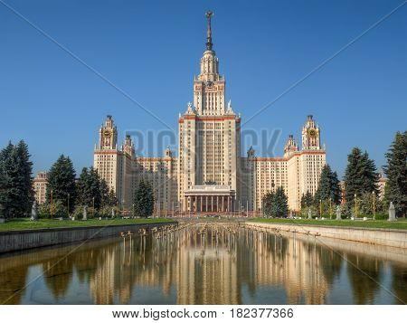 Lomonosov Moscow state university (or MSU) at summer morning against clear blue sky, reflected in a pond. This photo is HDR image, combined from 3 different exposures.