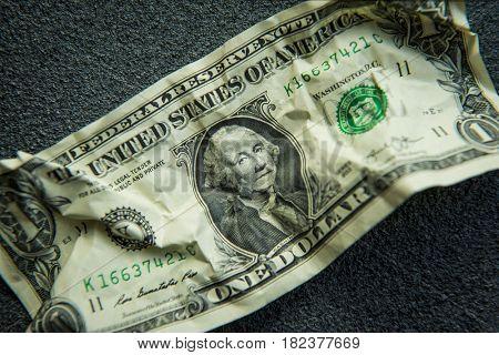 One dollar crumpled bill