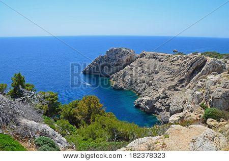 A rocky coastline with a small bay on the island of Mallorca