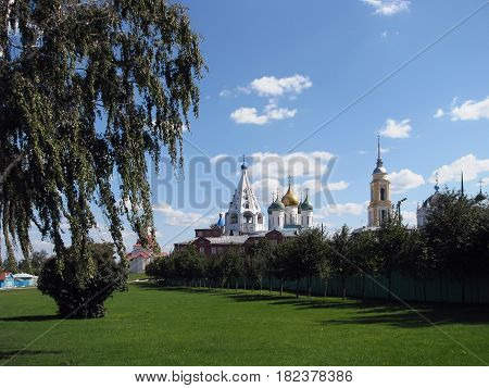 Kolomna view of the Cathedral with a lawn on a Sunny summer day with clouds in the sky