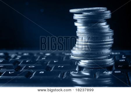 a coin pile over a keyboard