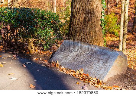 The memorial stone of Ernest Richardson in the Lullwater Park in sunny autumn day Atlanta USA