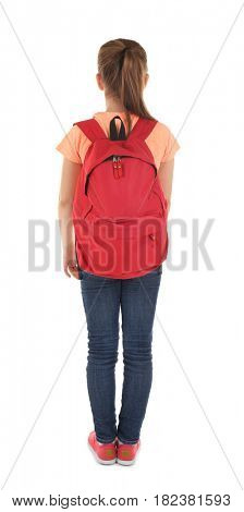 Incorrect posture concept. Cute schoolgirl with backpack on white background