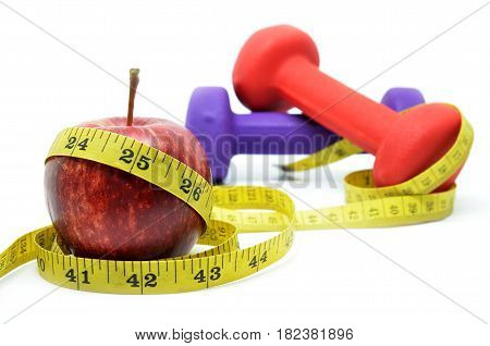 Dumbell With Measuring Tape And Red Apple