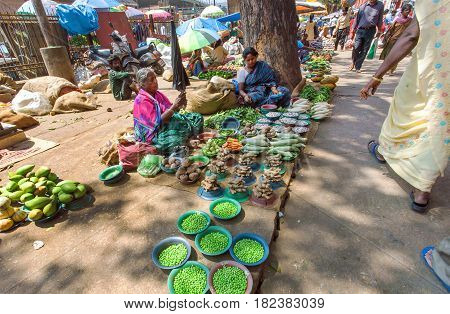 BANGALORE, INDIA - FEB 12, 2017: Street vendors selling green peas and other vegetables from ground on February 12, 2017. Capital of the state Karnataka has a population of 8.42 million