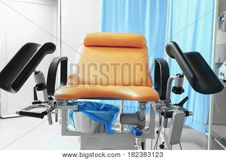 Gynecological examination chair in room