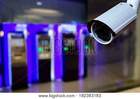 cctv security camera on blurred background of ATM Machine for withdraw or deposit cash money security technology concept
