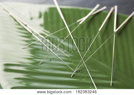Needles for acupuncture on decorative stand, closeup