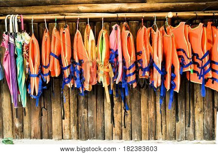 group of Life jacket or life vest or air jacket and colorful umbrella