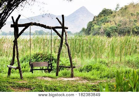 Swinging bench and in the garden and Landscape mountain with pond and Closeup of beautiful green sedge on bog in spring or summer