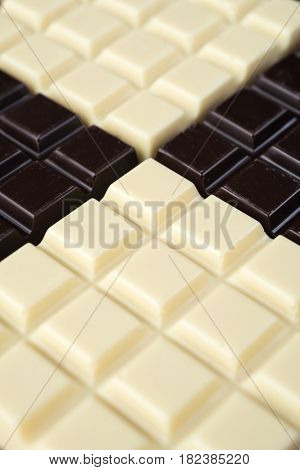 Dark and white chocolate bars combined together in a pattern