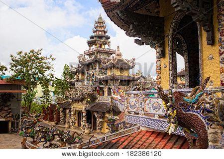 Linh Phuoc Pagoda in Da Lat, Vietnam. Dalat's famous landmark, buddhist porcelain glass temple. Linh Phuoc Pagoda in Dalat Vietnam also called Dragon Pagoda. Colorful horizontal image poster
